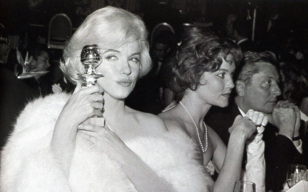 Marilyn Monroe displays her Golden Globe in 1951