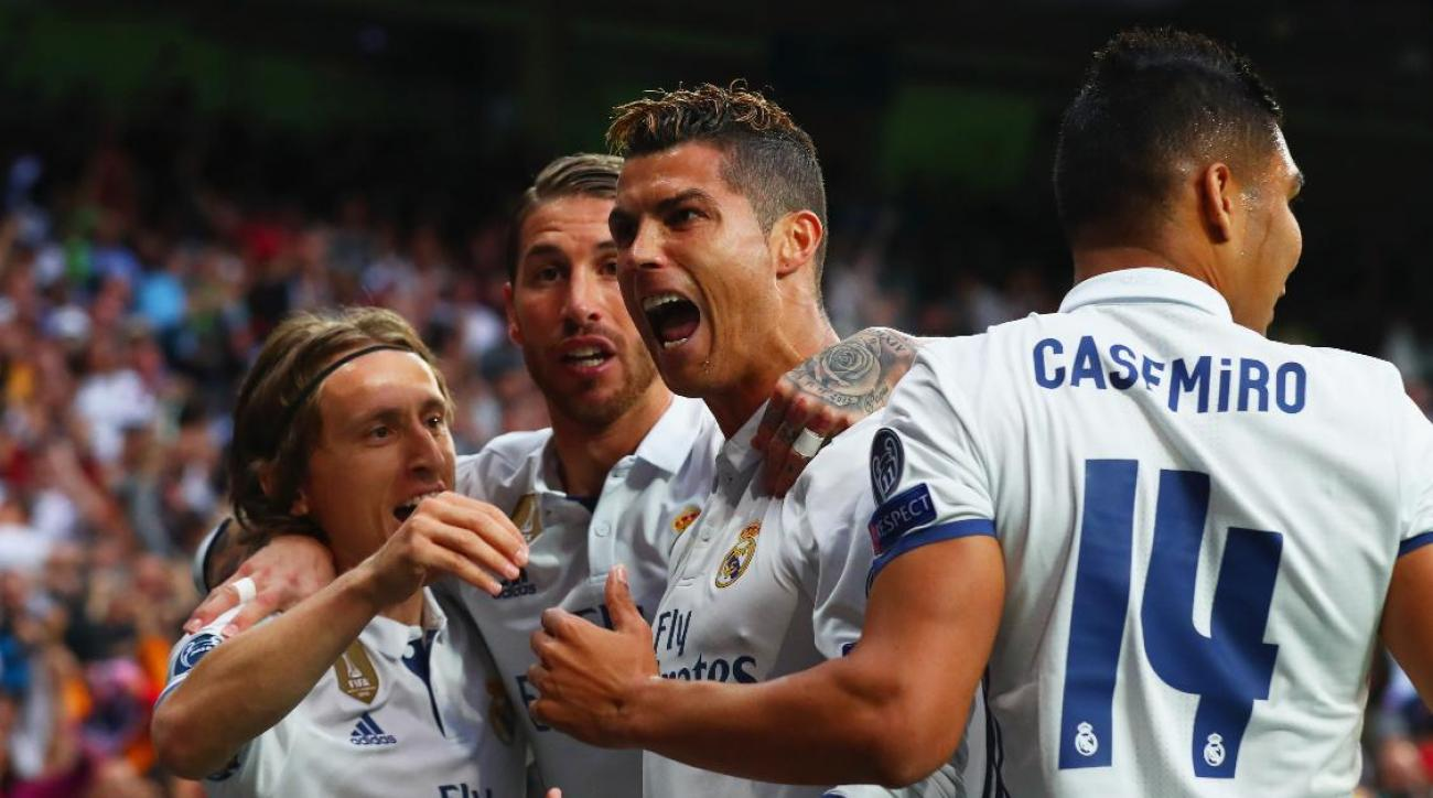 Real Madrid absorbs Atletico's best shot in Calderon farewell, survives to reach UCL final