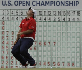 The Latest: Reed joins 65 club at Erin Hills.