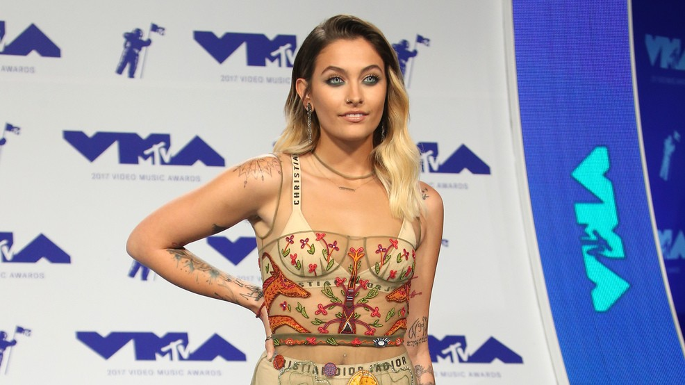 Paris Jackson poses topless to show off new chest tattoo